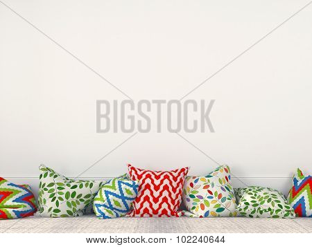 Colorful Cushions Near A White Wall