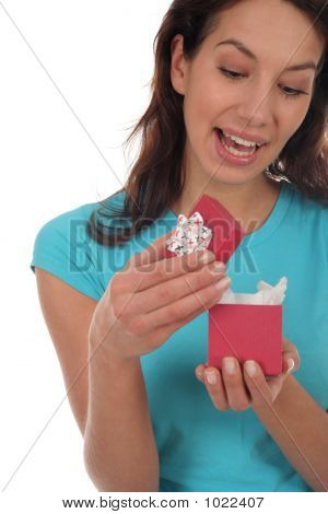 Woman Opening A Surprise Gift