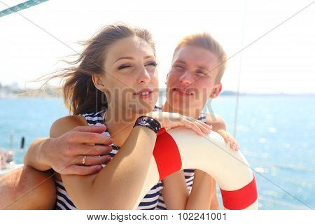 young couple traveling on a yacht