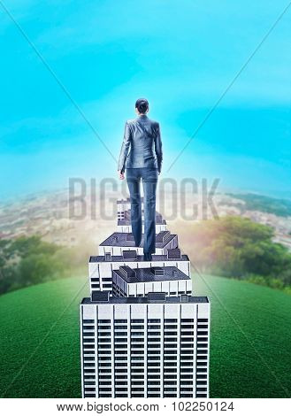 Woman walking on the roof of high building