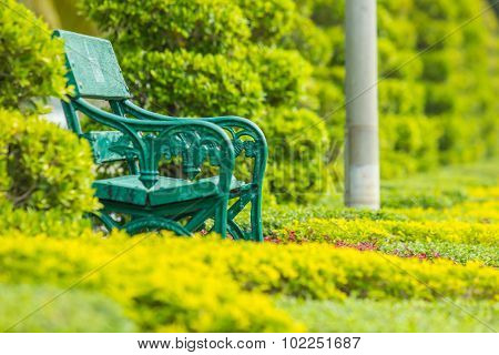 Lonely green chair in the public park.
