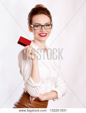 Close-up Portrait Of Young Smiling Business Woman Holding Credit Card Isolated On White Background