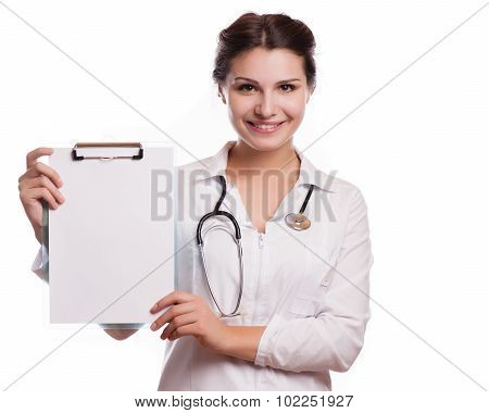 Portrait of young female doctor showing something or copyspase