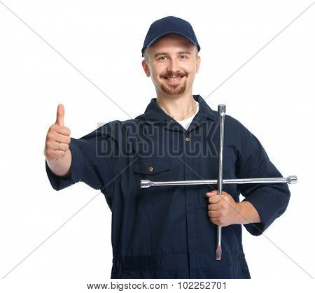 Smiling car mechanic with tire wrench isolated on white background.