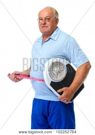 Senior man with scales and measuring tape isolated over white background.