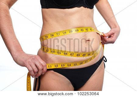 Woman measuring fat abdomen. Overweight and weight loss concept.