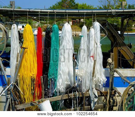 colorful floating nets of a fishing boat