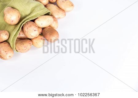 Potatoes tubers in a sack isolated on white background
