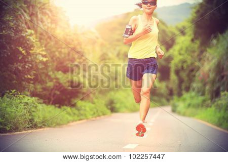 Runner athlete running on forest trail