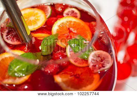 Red Lemonade with fresh orange on white background