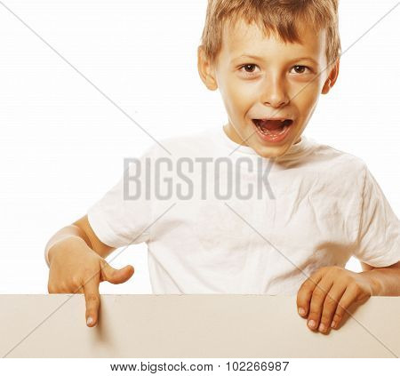 little cute boy holding empty shit to copyspace isolated close up