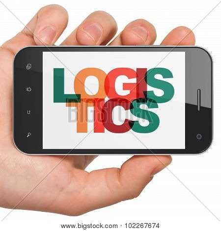 Finance concept: Hand Holding Smartphone with Logistics on  display