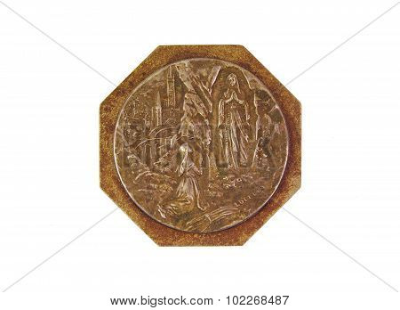 Bronce medal showing Our Lady of Lourdes isolated on white background