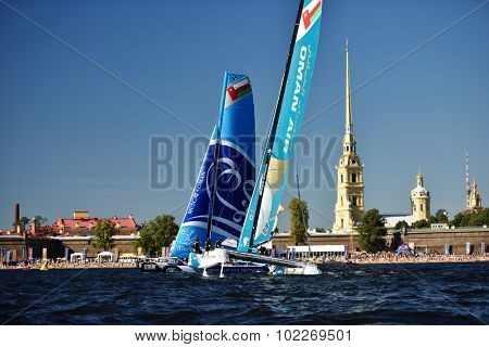 ST. PETERSBURG, RUSSIA - AUGUST 22, 2015: Two catamarans from Oman during the 3rd day of St. Petersburg stage of Extreme Sailing Series. The Wave, Muscat team of Oman leading after 2 days