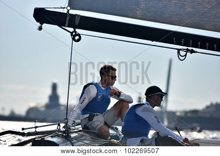 ST. PETERSBURG, RUSSIA - AUGUST 22, 2015: Skipper of Gazprom Team I. Lisovenko (left) and trimmer A. Bozhko of Russia on the catamaran during 3rd day of St. Petersburg stage of Extreme Sailing Series