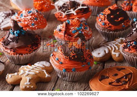 Halloween Cupcakes And Gingerbread Cookies Close-up. Horizontal