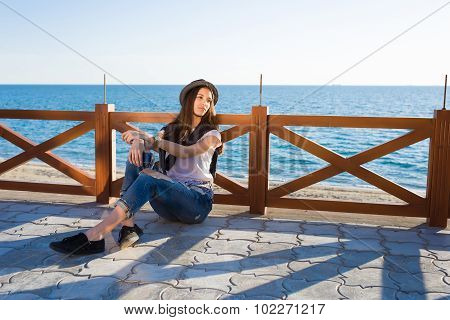 Thoughtful attractive woman dressed in stylish clothes enjoying good sunny weather during promenade