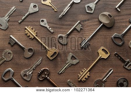 many different keys on wooden table