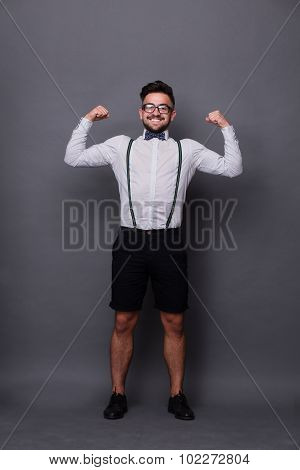 Strong hipster man in studio