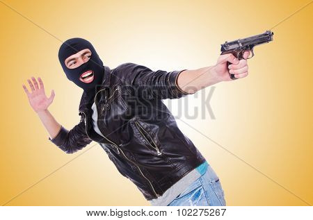 Young thug with gun isolated on white