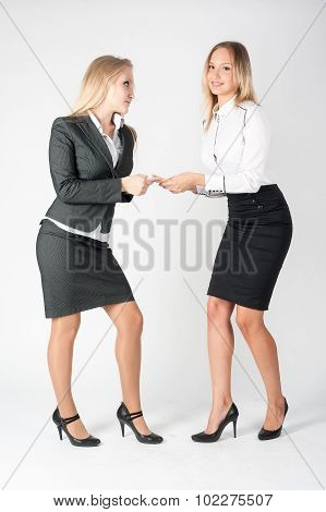 Argue of 2 young attractive businesswomen