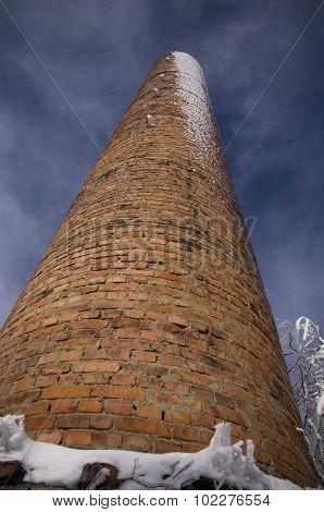 Brick chimney in winter
