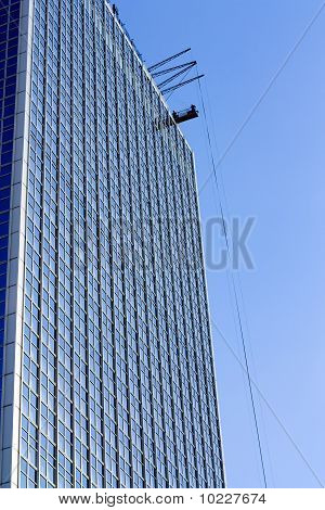High-rise Building With Window Washers