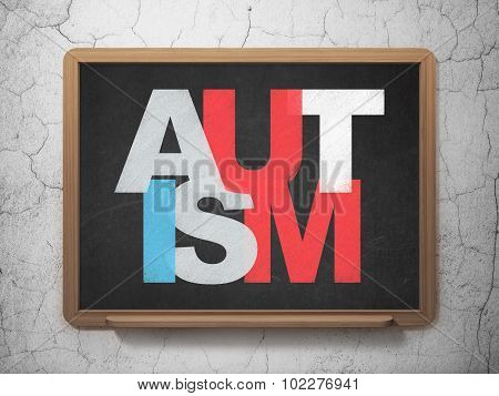 Medicine concept: Autism on School Board background