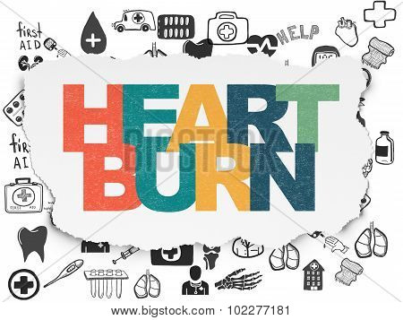 Health concept: Heartburn on Torn Paper background