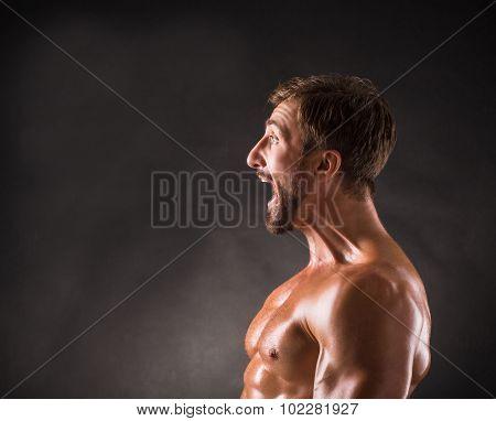Screaming shirtless mascular man