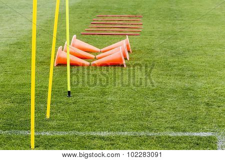 Soccer (football) Training Equipment On The Green Field Of The Stadium