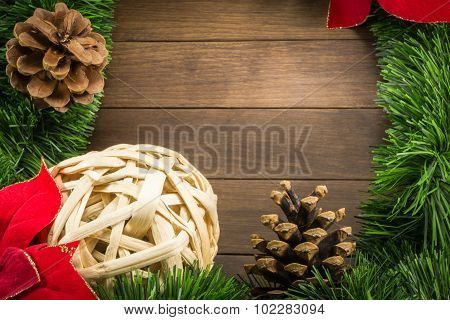 Christmas Decoration With Wicker Ball, Pine Cones And Poinsettia On Wooden Background