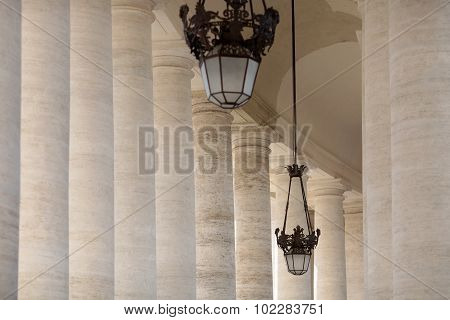White Columns And Street Lamps