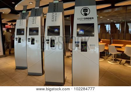 PARIS - AUGUST 08, 2015: McDonald's restaurant interior. McDonald's is the world's largest chain of hamburger fast food restaurants, founded in the United States.