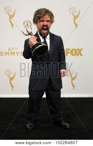 LOS ANGELES - SEP 20:  Peter Dinklage at the Primetime Emmy Awards Press Room at the Microsoft Theater on September 20, 2015 in Los Angeles, CA