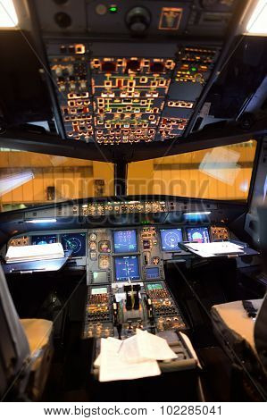 ROME, ITALY - AUGUST 04, 2015: Airbus A320 cockpit interior at night. The Airbus A320 family consists of short- to medium-range, narrow-body, commercial passenger twin-engine jet airliners