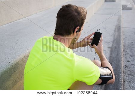 Young sports man use smart phone with blank copy pace screen for text message