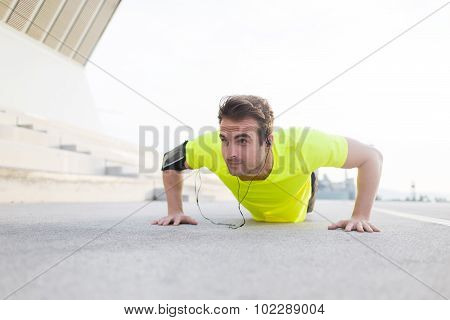 Young male jogger warm up before start his workout training outside in summer day