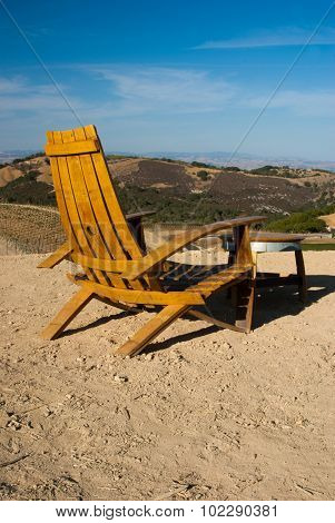 Chair And Table Overlooking Vineyards Of California