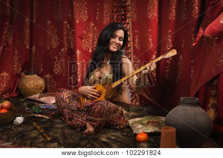 Beautiful Woman Playing The Dombra