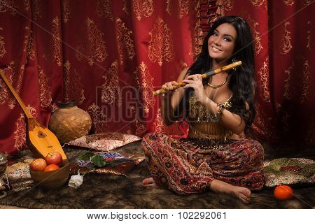 Beautiful Woman Playing The Flute