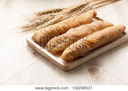 Curry Puff Stick On Wooden Background