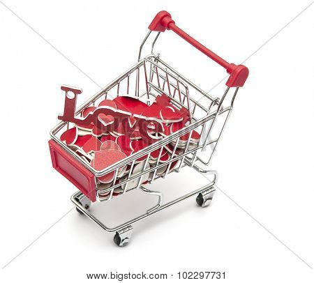 Supermarket trolley full of red hearts on white background