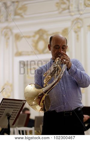 ST. PETERSBURG, RUSSIA - SEPTEMBER 7, 2015: Javier Bonet on the rehearsal during the International festival of French horn. The hornfest is held 3rd time
