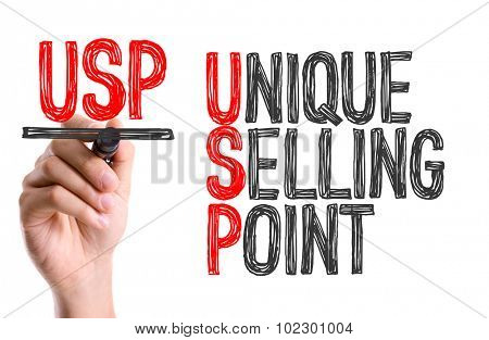 Hand with marker writing: Unique Selling Point