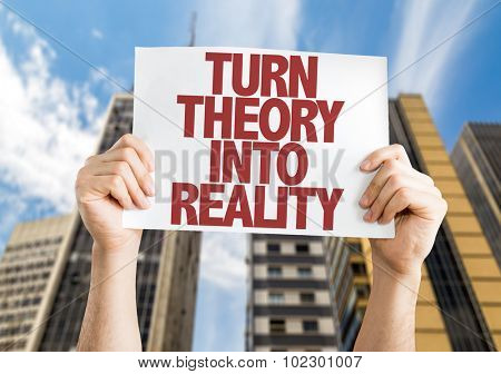 Turn Theory Into Reality placard with skyscrappers background