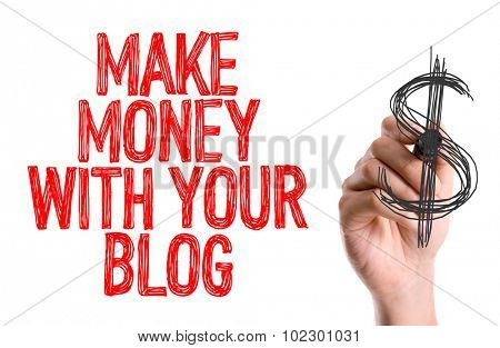 Hand with marker writing: Make Money With Your Blog