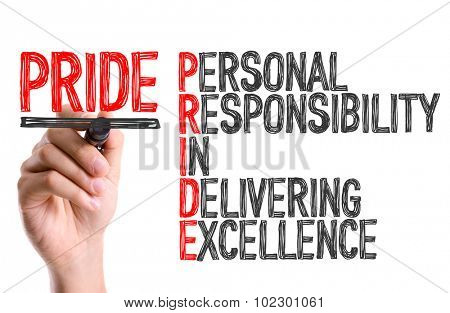 Hand with marker writing: Pride Acronym