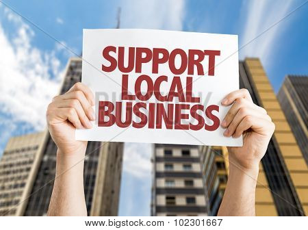 Support Local Business placard with skyscrappers background