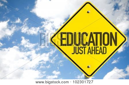 Education Just Ahead sign with sky background